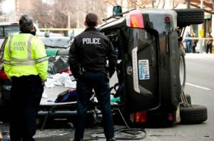 Maine police officers investigating SUV rollover on local street
