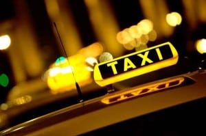 Taxi sign on top of Maine area taxi cab