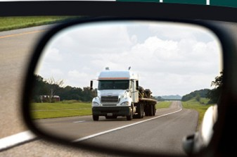 truck in car side mirror