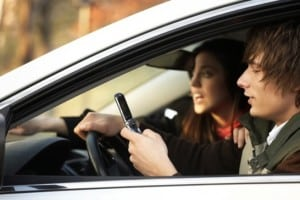Teens using cell phone while driving