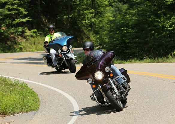 two men on motorcycles during the summer