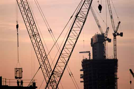 large cranes with two construction workers