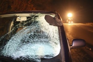 Car with broken windshield after crash with pedestrian